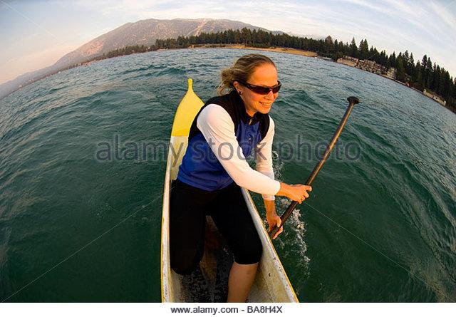 Woman Steering a Canoe, Lake Tahoe, California - Stock Image