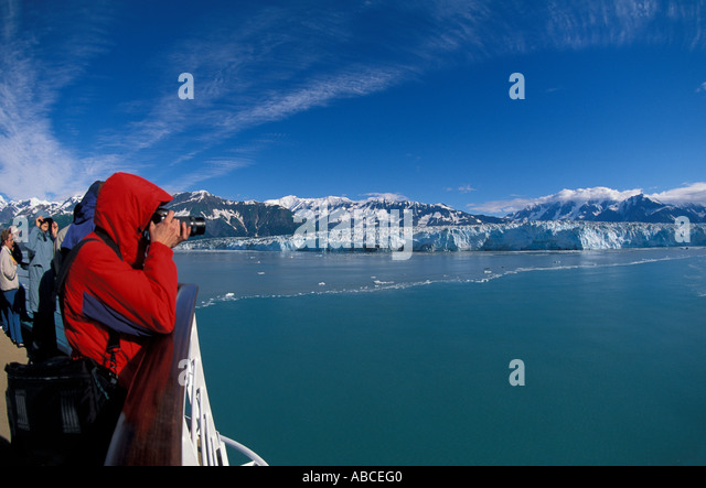 Alaska Hubbard Glacier cruise ship woman tourist red parka camera - Stock Image
