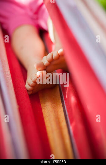 Sweden, Vastergotland, Lerum, Child in hammock - Stock-Bilder