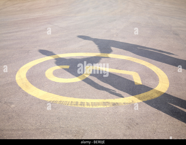 Shadow Of Handshake On Tarmac - Stock Image