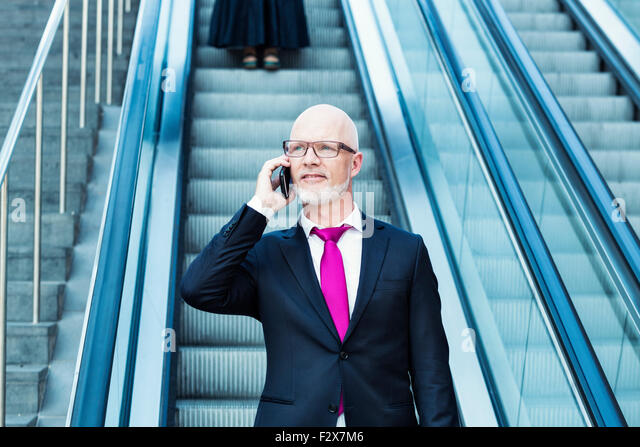 Germany, Berlin, Potsdam Square, business man with mobile phone - Stock Image