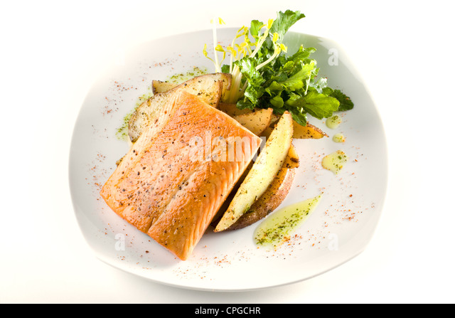 A dish of Chilean grilled Salmon over a bed of potatoes - Stock Image