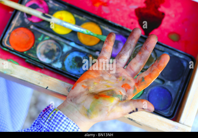 artist children painting watercolor brush self dirty hands - Stock-Bilder