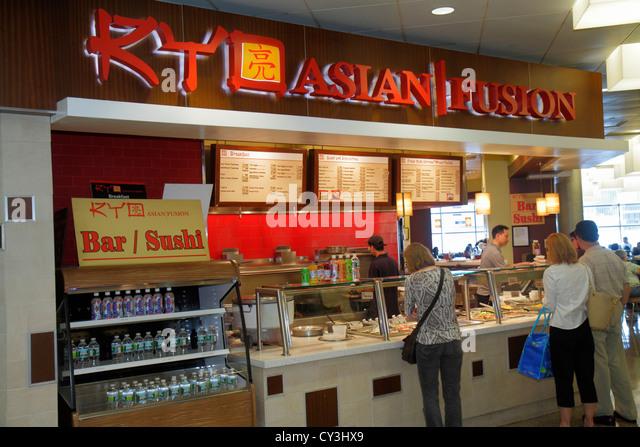 Boston Massachusetts Logan International Airport BOS gate area concourse RYO Asian/Fusion restaurant sushi man woman - Stock Image