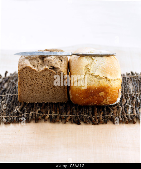 Farmhouse bread loaf and grey bread loaf - Stock Image
