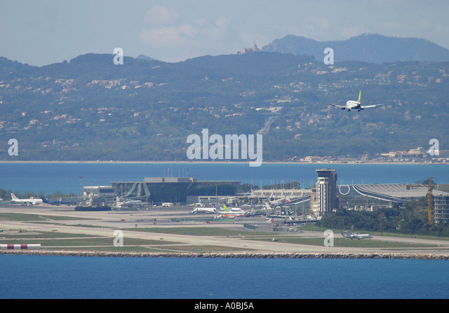 Aeroplane coming to land at Nice Airport France - Stock Image