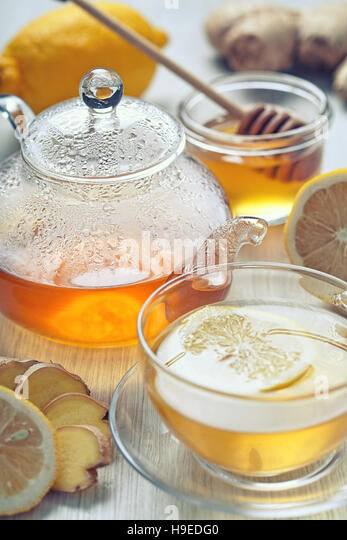 ginger tea with honey and lemon on wooden table - Stock Image