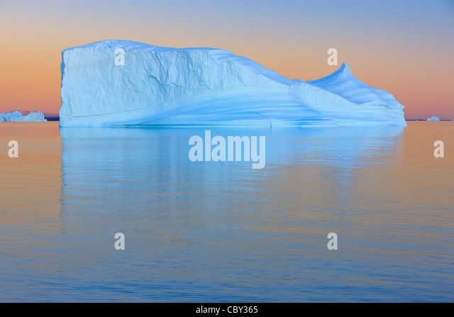 Iceberg at Sunset at Hall Bredning, Scoresbysund, Greenland - Stock Image