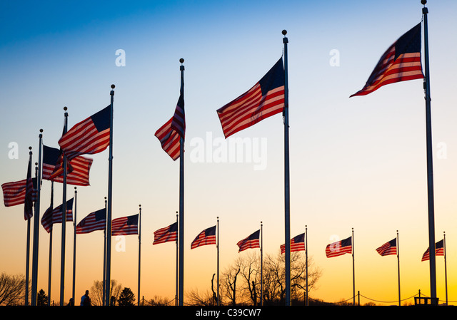 The flags surrounding the Washington Monument in Washington, DC at sunset - Stock Image