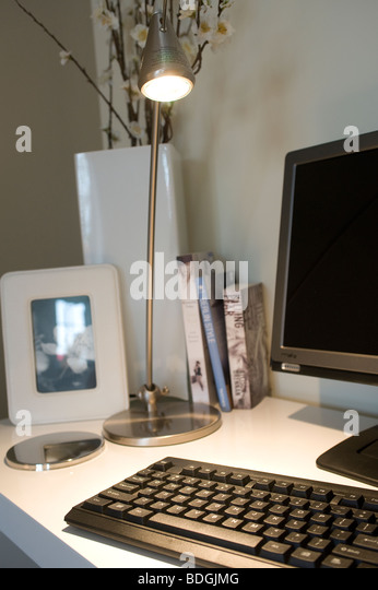 Computer in a home office / study. - Stock Image