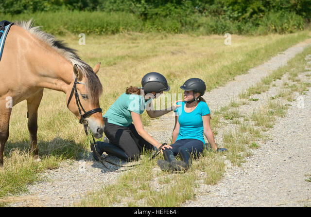 Riding accident, injured girl - Stock Image