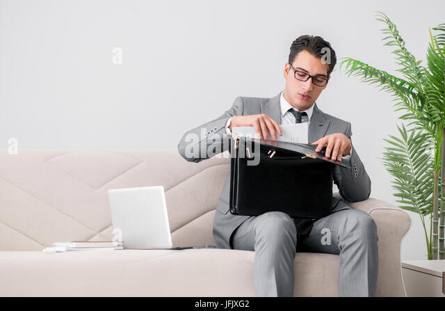 Businessman with briefcase in business concept - Stock Image