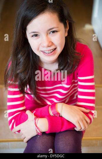 Portrait of girl with dental brace, smiling - Stock-Bilder