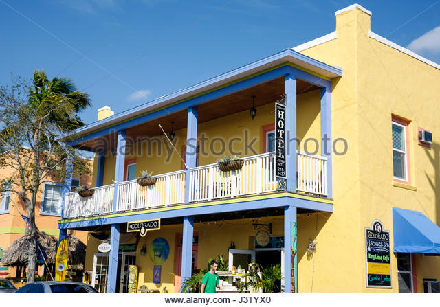 Stuart Florida Historic Downtown The Colorado building renovated shops business district man walking balcony railing - Stock Image