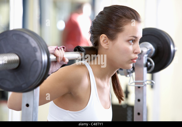 Photo of fit brunette practicing weightlifting - Stock Image