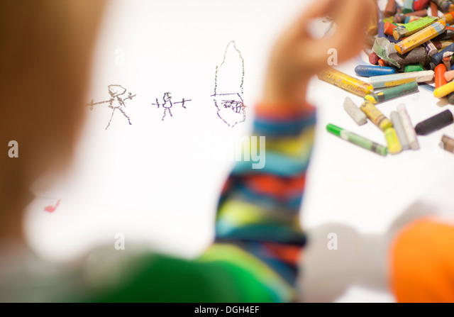 Child drawing with crayons - Stock-Bilder