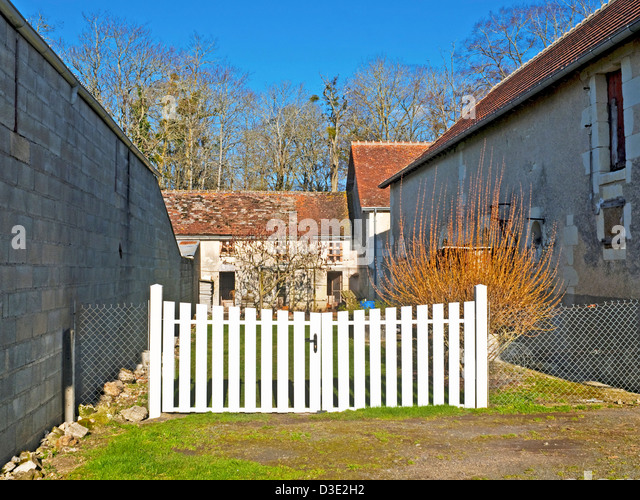 White plastic double gates - France. - Stock Image