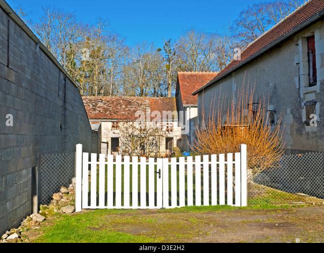 White plastic double gates - France. - Stock Image