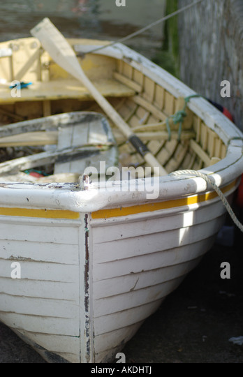 Bow of white rowing boat moored in Padstow sunny summer afternoon. - Stock Image