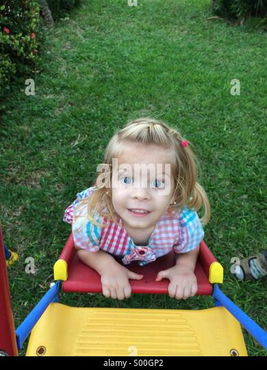 Cute little girl playing outside - Stock Image