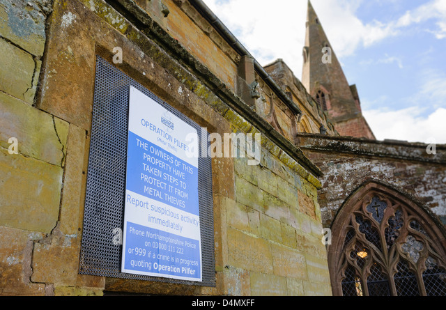 Sign on a church warning metal thieves that steps have been taken to prevent theft. - Stock Image
