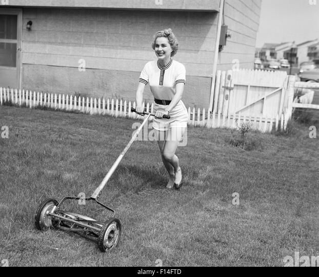 lawn mower old fashioned stock photos lawn mower old fashioned stock images alamy. Black Bedroom Furniture Sets. Home Design Ideas