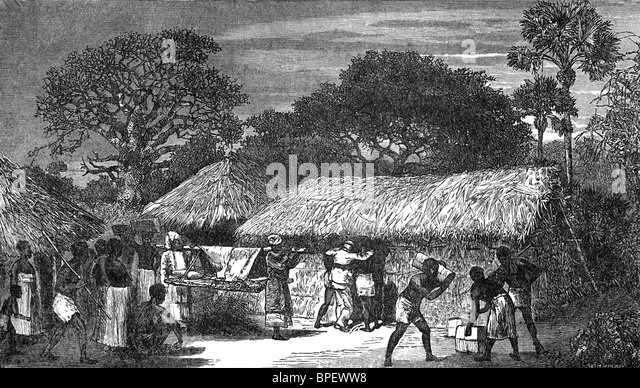 Scottish missionary and explorer in Africa. David  Livingstone is being taken into a hut at Ujiji on the night that - Stock Image