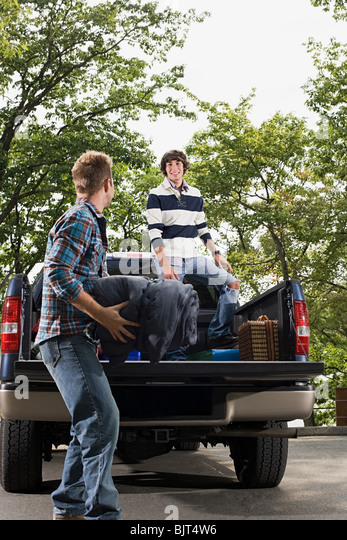 Friends and pick up truck - Stock Image