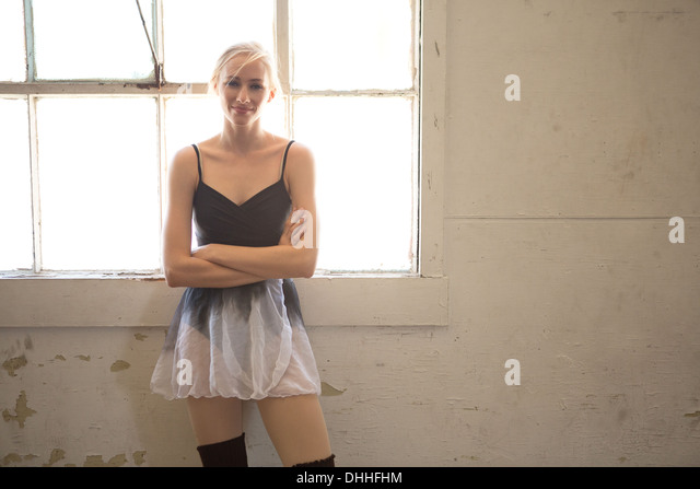 Portrait of ballet dancer with arms folded - Stock Image