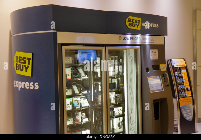 Texas Houston George Bush Intercontinental Airport IAH terminal concourse gate area Best Buy Express electronics - Stock Image