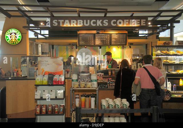 Nevada Las Vegas McCarran International Airport LAS terminal concourse gate area Starbucks Coffee cafe line queue - Stock Image