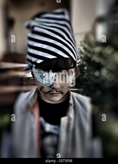 Toddler dressed up as pirate - Stock Image