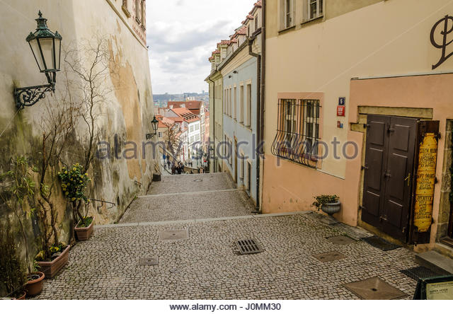 Tourists walking down Ke hradu - street leading from the castle to Nerudova. - Stock Image