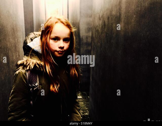 Girl surrounded by concrete - Stock-Bilder