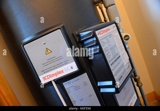 Dimplex night storage heaters and hot water backup in private housing energy efficient system - Stock Image