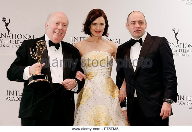 epa05039288 British actor Julian Fellows (L) holds the International Emmy Founders Award while standing with US - Stock Image
