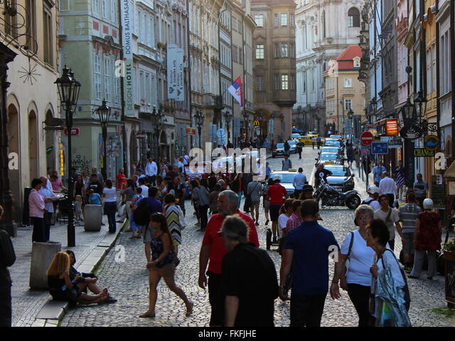 Busy street on a sunny evening in Prague, Czech Republic - Stock Image