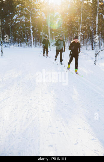 Sweden, Skiers outdoors in winter - Stock Image