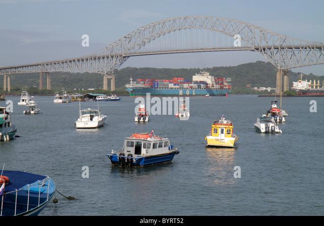 Panama Panama City Amador Panama Canal Pacific Ocean approach Puente de las Americas Thatcher Ferry Bridge boat - Stock Image