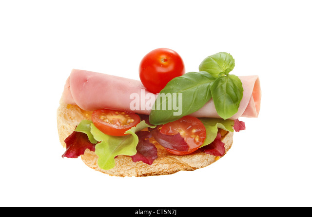 Ham and salad open sandwich isolated against white - Stock Image