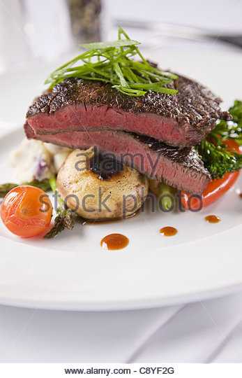 Steak with mushrooms and potato bake - Stock Image
