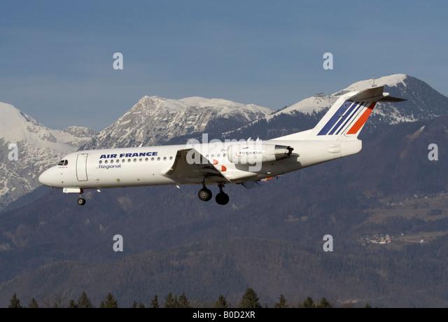Commercial air travel. Air France Fokker 70 jet plane landing at Ljubljana Airport, Slovenia - Stock-Bilder