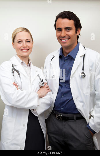 Portrait Of Male And Female Doctors - Stock Image