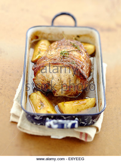 Roast pork with apples and cider - Stock Image
