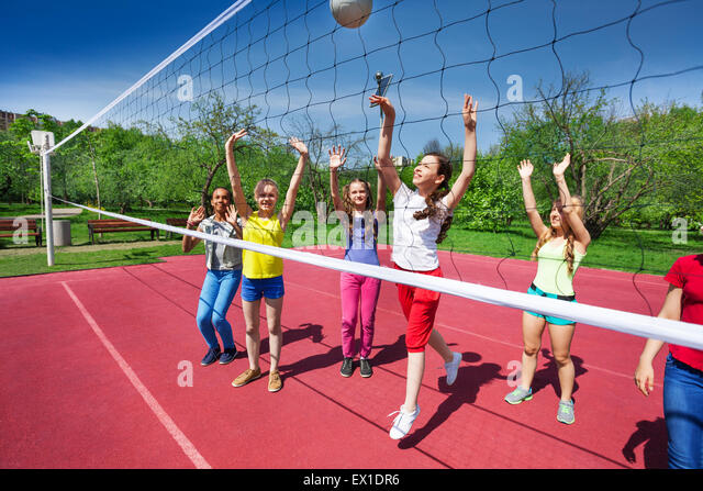 Volleyball game view with teenagers who play - Stock Image