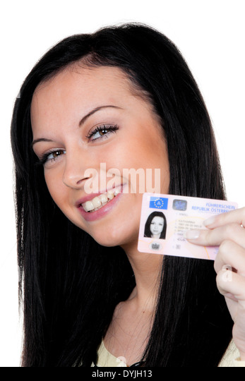 Woman with car keys and driver's license. Driving test, Frau mit Fuehrerschein. Fahrpruefung - Stock Image