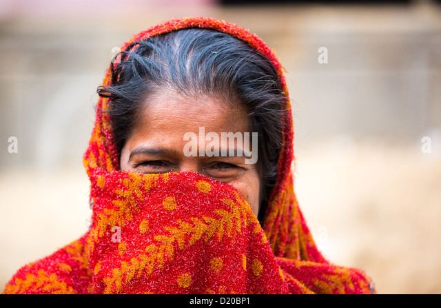 Bashful, smiling woman in Delhi, India - Stock Image