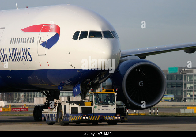 Boeing 777 236 ER British Airways transported by ground crew for service - Stock Image