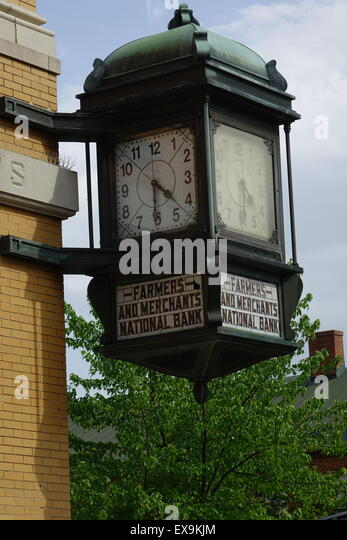 Antique clock at the corner of the Farmers and Merchants National Bank building, Old Town pedestrian mall, Winchester, - Stock Image