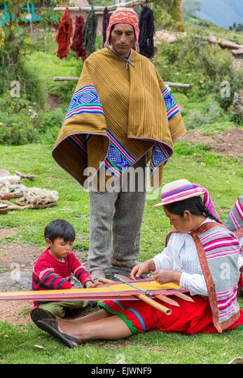 Peru, Urubamba Valley, Quechua Village of Misminay.  Father, Mother, and Son. - Stock-Bilder